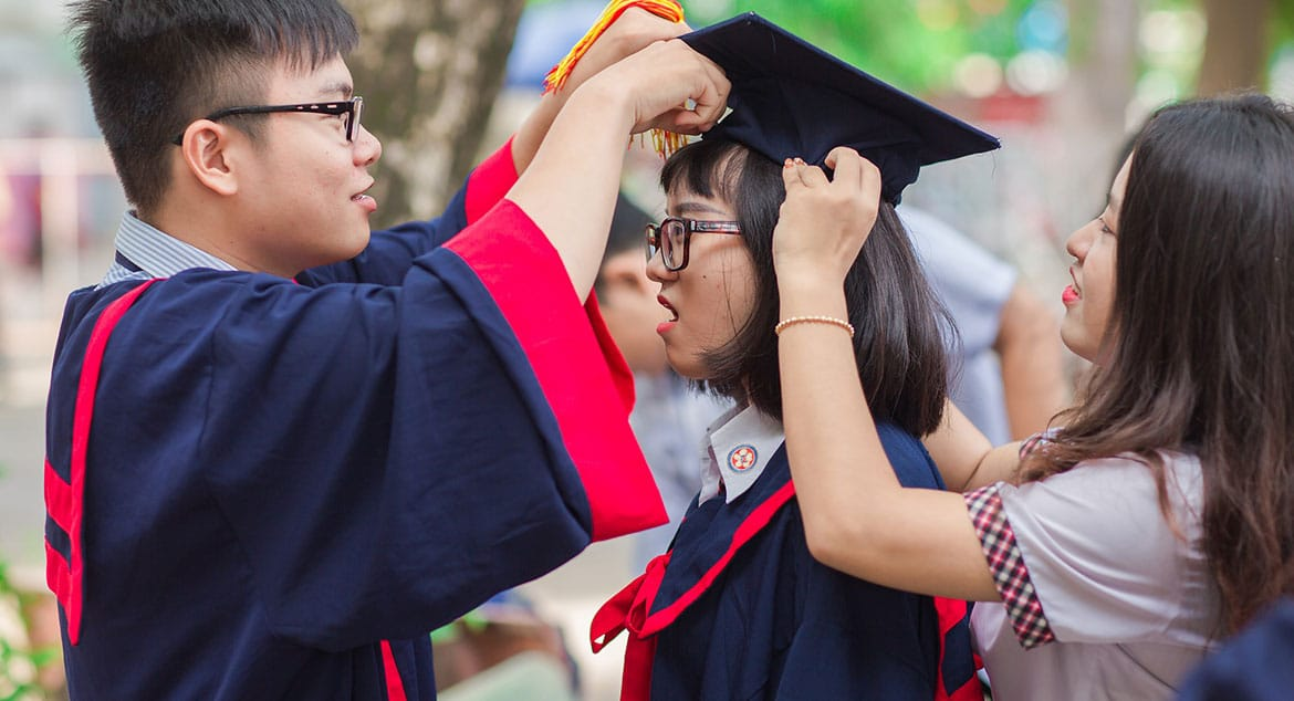 A Chinese student receiving her hat at her graduating ceremony